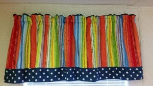 multi colored drapes with polka dots on bottom